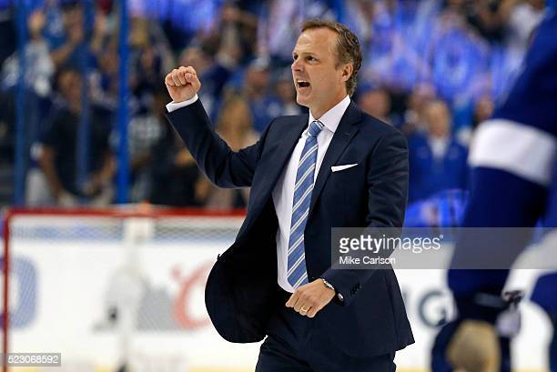 Jon Cooper of the Tampa Bay Lightning celebrates after a series win over the Detroit Red Wings in Game Five of the Eastern Conference First Round...