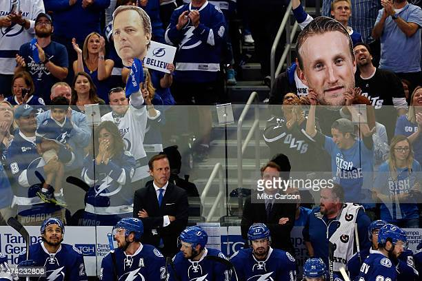 Jon Cooper of the Tampa Bay Lightning looks on from the bench against the New York Rangers during Game Three of the Eastern Conference Finals during...
