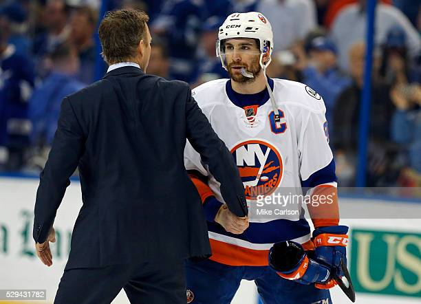 Jon Cooper of the Tampa Bay Lightning shakes hands with John Tavares of the New York Islanders after Game Five of the Eastern Conference Second Round...