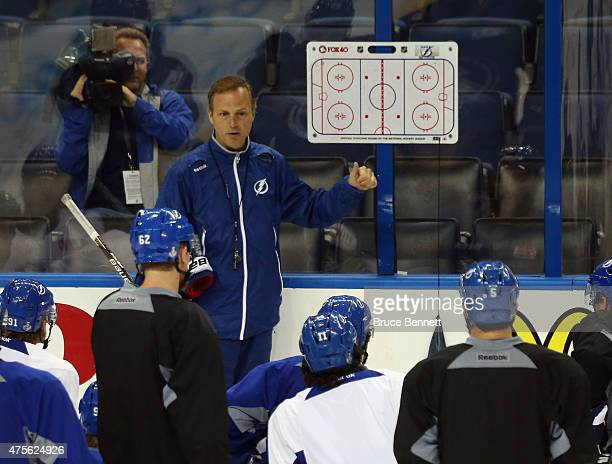 Jon Cooper of the Tampa Bay Lightning speaks with his team during the practice day prior to the 2015 NHL Stanley Cup Finals at Amalie Arena on June 2...