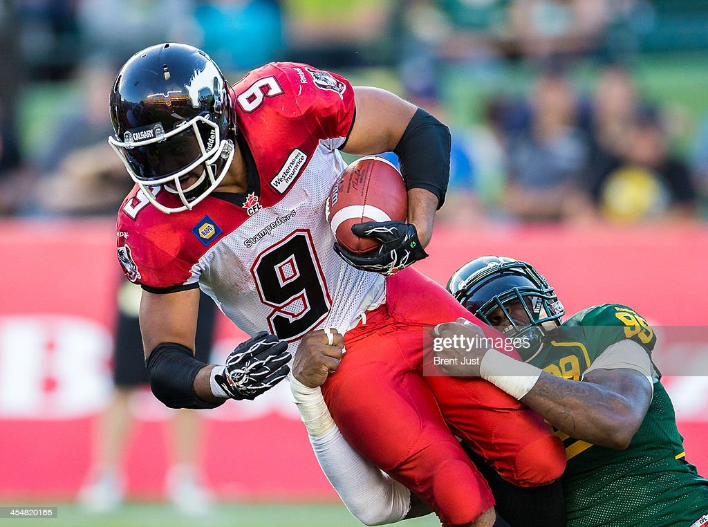 ... new zealand calgary stampeders jon cornish 9 of the calgary stampeders  is dragged down by jersey 6d856d44c