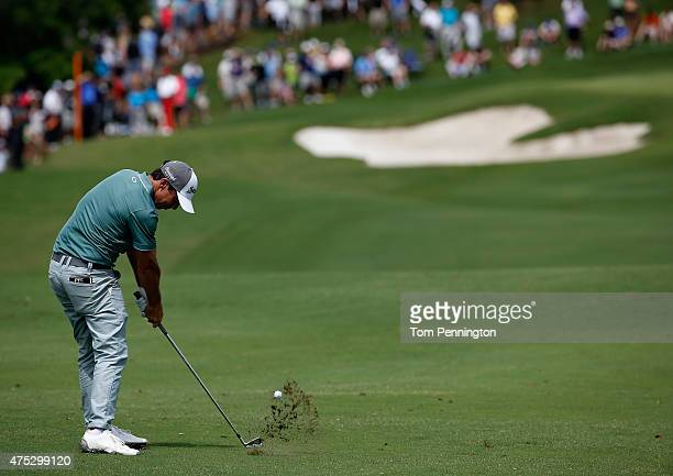 Jon Curran hits his approach shot on the first hole during Round Three of the ATT Byron Nelson at the TPC Four Seasons Resort Las Colinas on May 30...