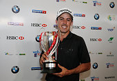 Jon Curran of the USA poses in the clubhouse with the trophy after his fourstroke victory at the 2014 Brasil Champions Presented by HSBC at the Sao...