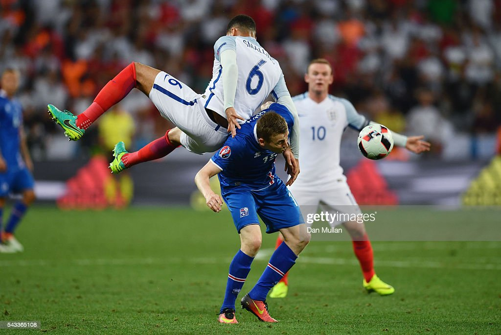 Jon Dadi Bodvarsson of Iceland and <a gi-track='captionPersonalityLinkClicked' href=/galleries/search?phrase=Chris+Smalling&family=editorial&specificpeople=5964313 ng-click='$event.stopPropagation()'>Chris Smalling</a> of England compete for the ball during the UEFA EURO 2016 round of 16 match between England and Iceland at Allianz Riviera Stadium on June 27, 2016 in Nice, France.