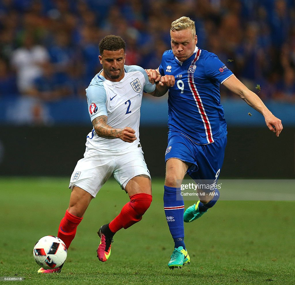 Jon Dadi Bodvarsson of Iceland competes with <a gi-track='captionPersonalityLinkClicked' href=/galleries/search?phrase=Kyle+Walker&family=editorial&specificpeople=5609702 ng-click='$event.stopPropagation()'>Kyle Walker</a> of England during the UEFA Euro 2016 Round of 16 match between England and Iceland at Allianz Riviera Stadium on June 27, 2016 in Nice, France.