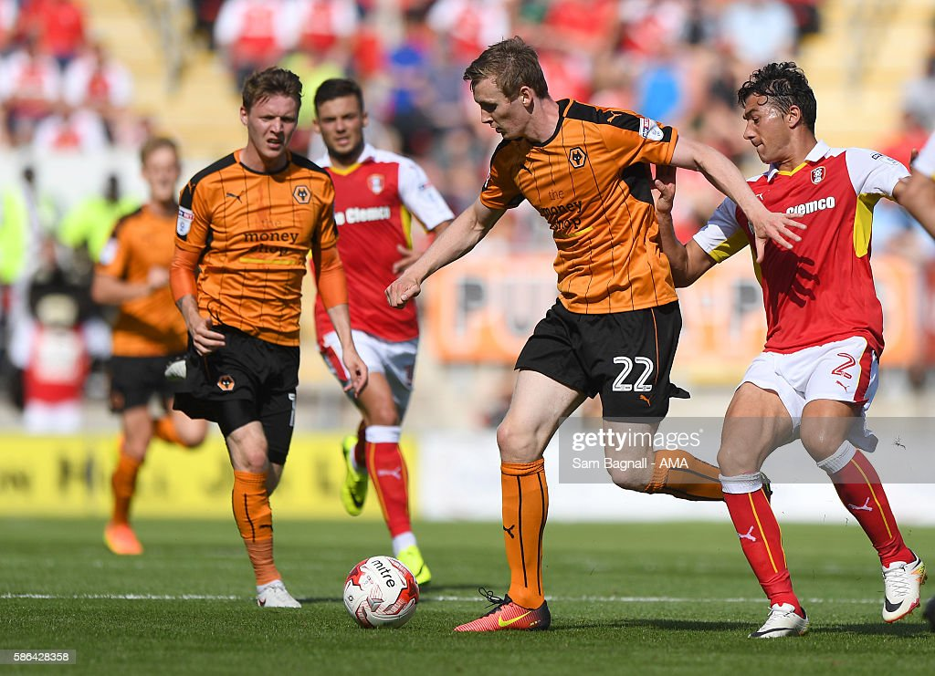 Jon Dadi Bodvarsson of Wolverhampton Wanderers and Stephen Kelly of Rotherham United during the Sky Bet Championship match between Rotherham United v Wolverhampton Wanderers at The New York Stadium on August 6, 2016 in Rotherham, England.