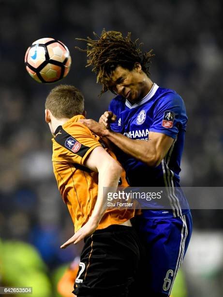 Jon Dadi Bodvarsson of Wolves and Nathan Ake of Chelsea battle to win a header during The Emirates FA Cup Fifth Round match between Wolverhampton...