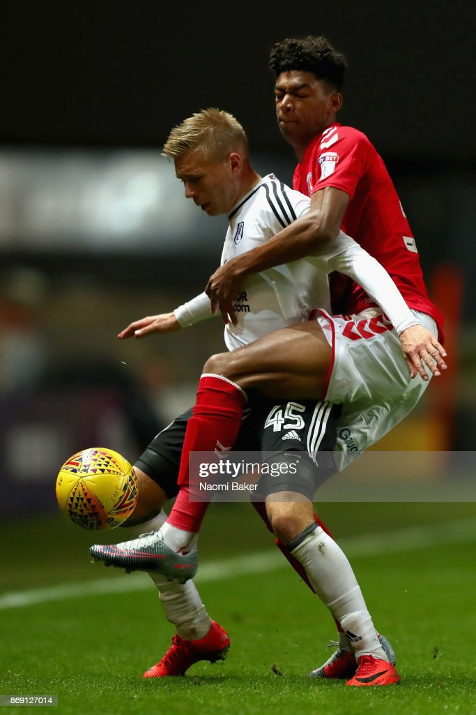 Jon Dagur Thorsteinsson of Fulham and Reeco Hackett-Fairchild of Charlton battle for posession during the Checkatrade Trophy match between Charlton and Fulham at The Valley on November 1, 2017 in London, England.