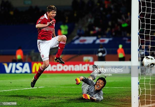 Jon Dahl Tomasson of Denmark scores the rebound from a penalty saved by Eiji Kawashima of Japan during the 2010 FIFA World Cup South Africa Group E...