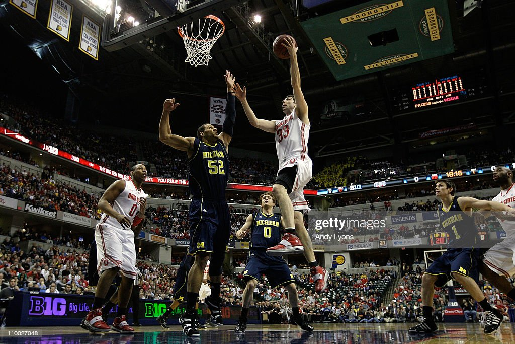 Jon Diebler of the Ohio State Buckeyes drives for a shot attempt against Jordan Morgan of the Michigan Wolverines during the semifinals of the 2011...