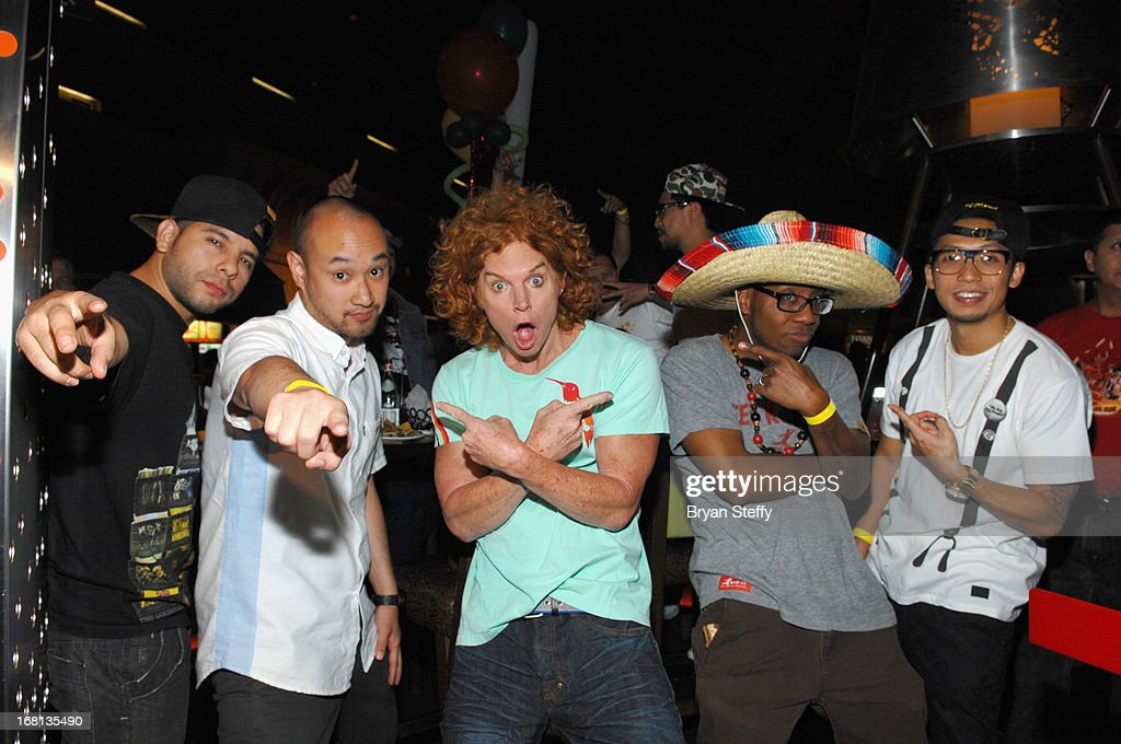 Jon 'Do Knock' Cruz and Jeffrey Nguyen from the Jabbawockeez and comedian Carrot Top and members of the Jabbawockeez Kevin Brewer and Ben Chung appear during Tacos & Tequila's Cinco de Mayo celebration at the Luxor Resort & Casino on May 5, 2013 in Las Vegas, Nevada.