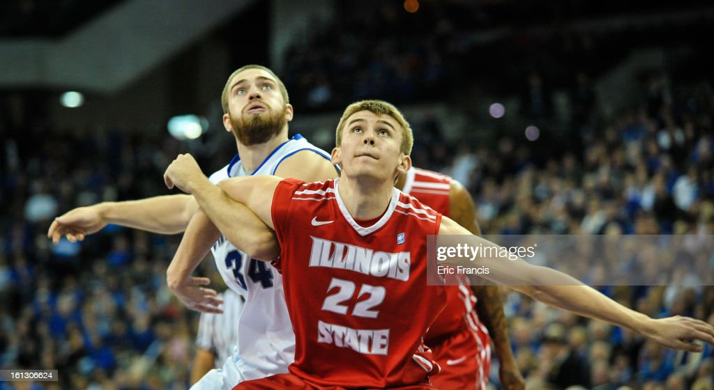 Jon Ekey #22 of the Illinois State Redbirds and Ethan Wragge #34 of the Creighton Bluejays battle for position during their game at the CenturyLink Center on February 9, 2013 in Omaha, Nebraska.