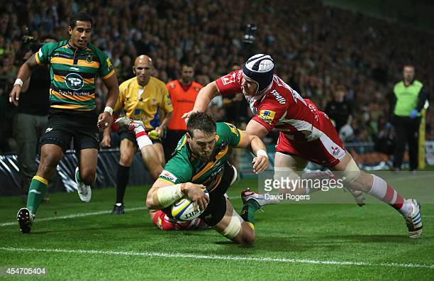 Jon Fisher of Northampton dives over to score their sixth try during the Aviva Premiership match between Northampton Saints and Gloucester at...