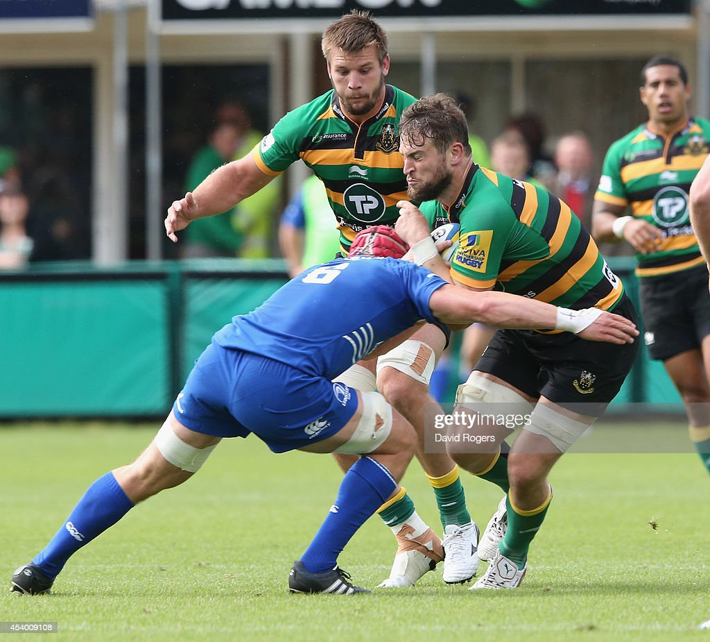 Jon Fisher of Northampton is tackled during the pre season friendly match between Northampton Saints and Leinster at Franklin's Gardens on August 23, 2014 in Northampton, England.
