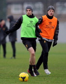 Jon Flanagan and Brad Smith of Liverpool in action during a training session at Melwood Training Ground on January 31 2014 in Liverpool England