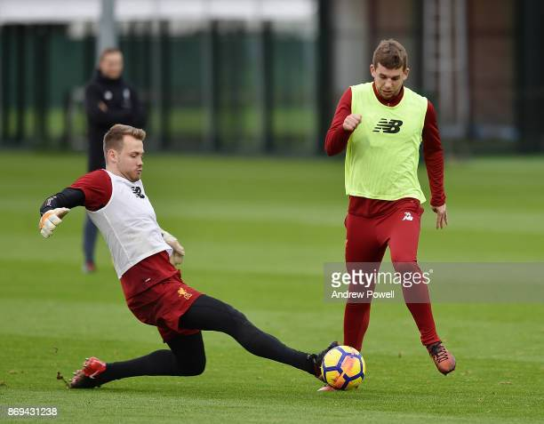 Jon Flanagan and Simon Mignolet of Liverpool during a training session at Melwood Training Ground on November 2 2017 in Liverpool England