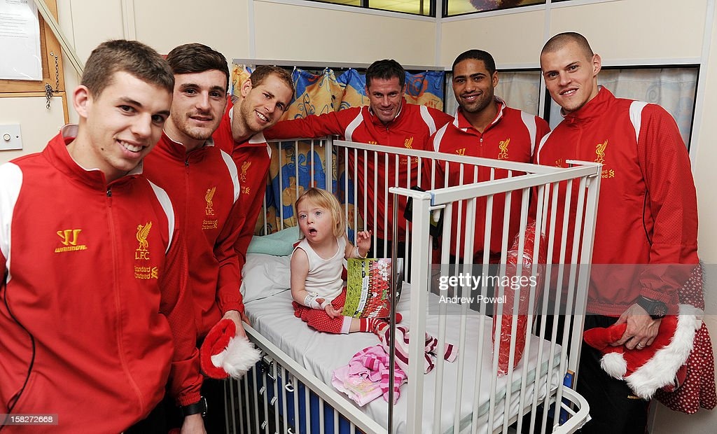 <a gi-track='captionPersonalityLinkClicked' href=/galleries/search?phrase=Jon+Flanagan+-+Soccer+Player+-+Born+1993&family=editorial&specificpeople=8957850 ng-click='$event.stopPropagation()'>Jon Flanagan</a>, Jack Robinson, <a gi-track='captionPersonalityLinkClicked' href=/galleries/search?phrase=Peter+Gulacsi&family=editorial&specificpeople=5446277 ng-click='$event.stopPropagation()'>Peter Gulacsi</a>, <a gi-track='captionPersonalityLinkClicked' href=/galleries/search?phrase=Jamie+Carragher&family=editorial&specificpeople=206485 ng-click='$event.stopPropagation()'>Jamie Carragher</a>, <a gi-track='captionPersonalityLinkClicked' href=/galleries/search?phrase=Glen+Johnson&family=editorial&specificpeople=209192 ng-click='$event.stopPropagation()'>Glen Johnson</a> and <a gi-track='captionPersonalityLinkClicked' href=/galleries/search?phrase=Martin+Skrtel&family=editorial&specificpeople=5554576 ng-click='$event.stopPropagation()'>Martin Skrtel</a> of Liverpool FC visit Alder Hey Children's Hospital on December 12, 2012 in Liverpool, England.