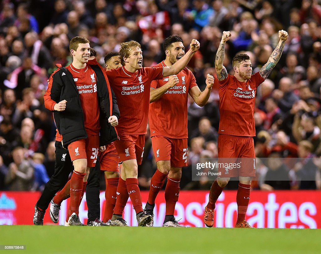 Jon Flanagan, Lucas Leiva, Emre Can and Christian Benteke of Liverpool celebrate at the end of the Capital One Cup Semi Final: Second Leg between Liverpool and Stoke City at Anfield on January 26, 2016 in Liverpool, England.