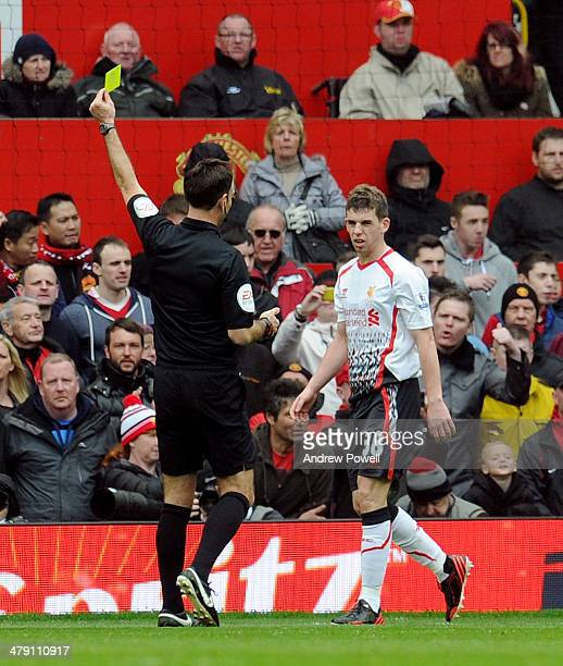 Jon Flanagan of Liverpool booked during the Barclays Premier Leauge match between Manchester United and Liverpool at Old Trafford on March 16 2014 in...