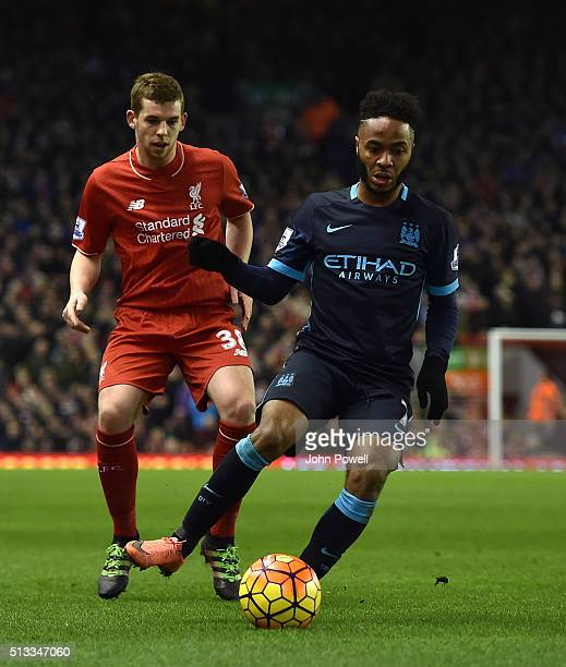 Jon Flanagan of Liverpool competes with Raheem Sterling of Manchester City during the Barclays Premier League match between Liverpool and Manchester...