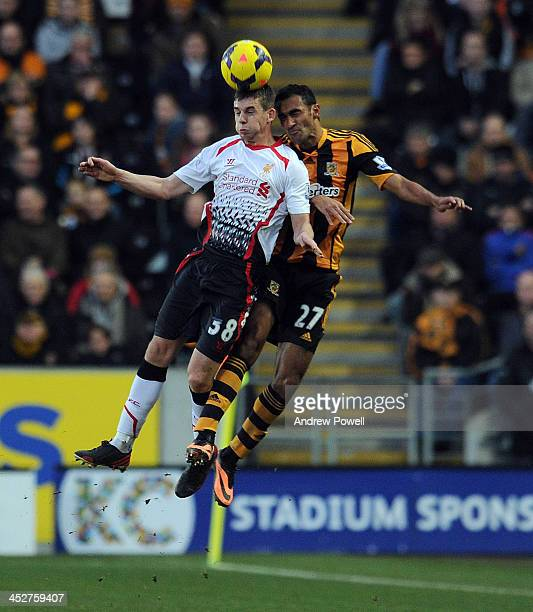Jon Flanagan of Liverpool goes up with Ahmed Elmohamady of Hull City during the Barclays Premier League match between Hull City and Liverpool at the...