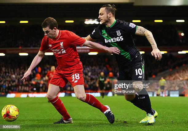 Jon Flanagan of Liverpool holds off Marko Arnautovic of Stoke City during the Capital One Cup semi final second leg match between Liverpool and Stoke...