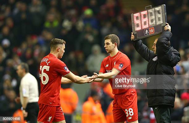 Jon Flanagan of Liverpool replaces Connor Randall of Liverpool during The Emirates FA Cup Third Round Replay match between Liverpool and Exeter City...