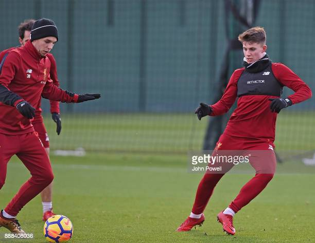 Jon Flanagan with Ben Woodburn of Liverpool during a training session at Melwood Training Ground on December 8 2017 in Liverpool England