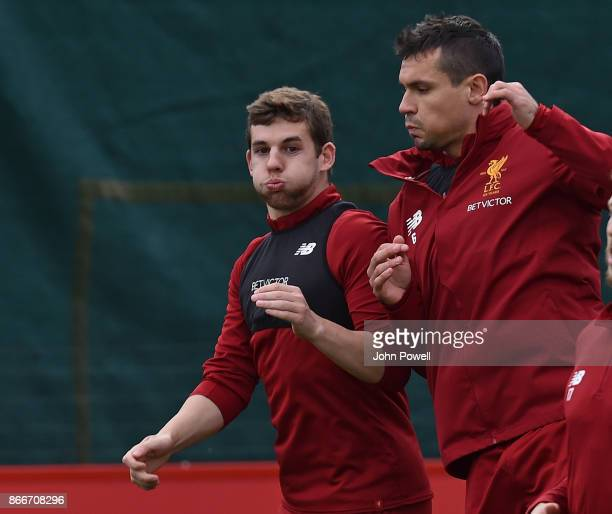 Jon Flanagan with Dejan Lovren of Liverpool during a training session at Melwood Training Ground on October 26 2017 in Liverpool England