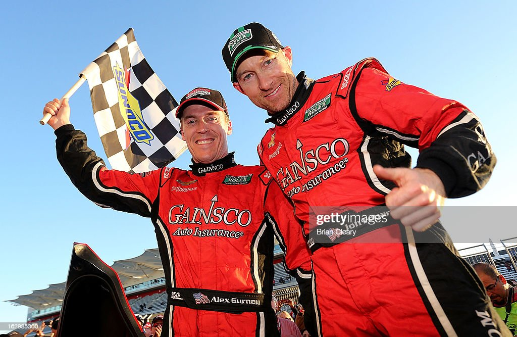 Jon Fogarty (R) and Alex Gurney celebrate their victory in the Grand-Am of the Americas at Circuit of The Americas on March 2, 2013 in Austin, Texas.