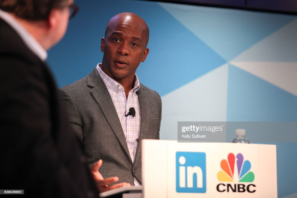 Jon Fortt, Co-Anchor of CNBC's Squawk Alley, moderates a debate between Reid Hoffman and Tim O'Reilly on August 23, 2017 at LinkedIn in San Francisco, California.