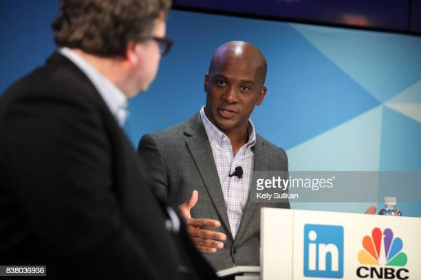 Jon Fortt CoAnchor of CNBC's Squawk Alley moderates a debate between Reid Hoffman and Tim O'Reilly on August 23 2017 at LinkedIn in San Francisco...