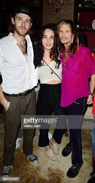 Jon Foster Chelsea Tyler of BadBad and her father Steven Tyler pose for picture after performing on December 7 2013 in Fort Lauderdale Florida