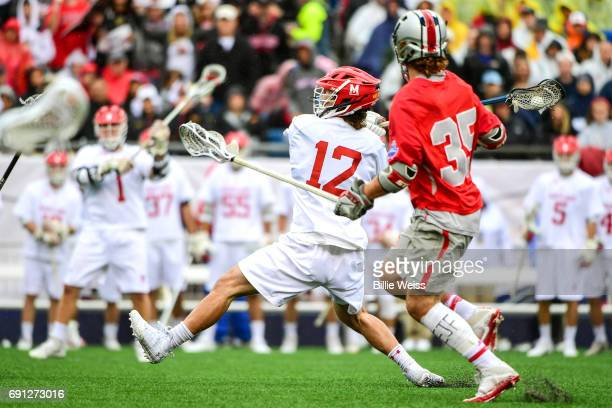 Jon Garino Jr #12 of the Maryland Terrapins shoots the ball during the Division I Men's Lacrosse Championship against the Ohio State Buckeyes at...