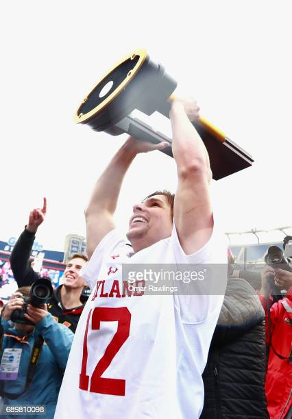 Jon Garino of the Maryland Terrapins lifts the trophy after defeating the Ohio State Buckeyes in the NCAA Division I Menâs Lacrosse Championship at...