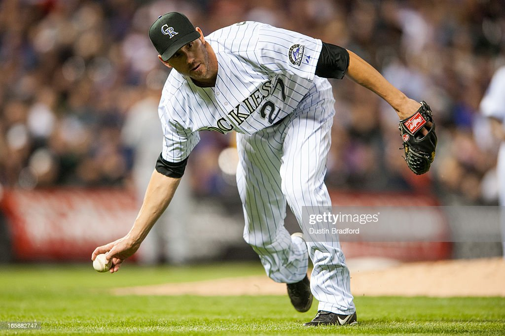 <a gi-track='captionPersonalityLinkClicked' href=/galleries/search?phrase=Jon+Garland&family=editorial&specificpeople=209155 ng-click='$event.stopPropagation()'>Jon Garland</a> #27 of the Colorado Rockies fields a bunt and makes an out at first in the sixth inning of a game against the San Diego Padres at Coors Field on April 6, 2013 in Denver, Colorado. The Rockies Beat the Padres 6-3.