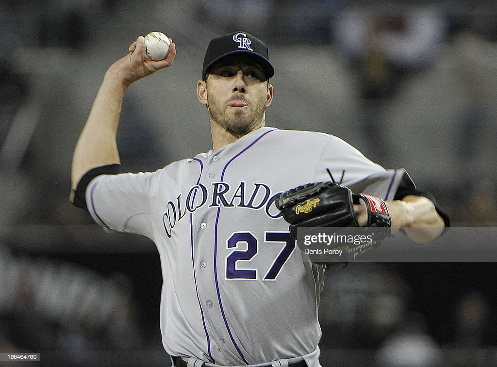 <a gi-track='captionPersonalityLinkClicked' href=/galleries/search?phrase=Jon+Garland&family=editorial&specificpeople=209155 ng-click='$event.stopPropagation()'>Jon Garland</a> #27 of the Colorado Rockies pitches in the first inning against the San Diego Padres at Petco Park on April 12, 2013 in San Diego, California.