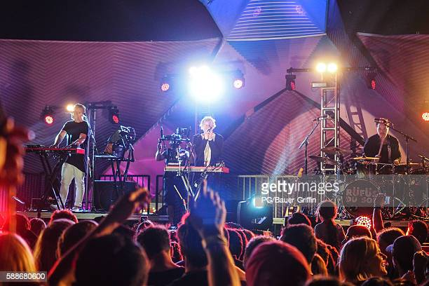 Jon George Tyrone Lindqvist and James Hunt of Rufus du Sol perform on the Santa Monica Pier on August 11 2016 in Los Angeles California