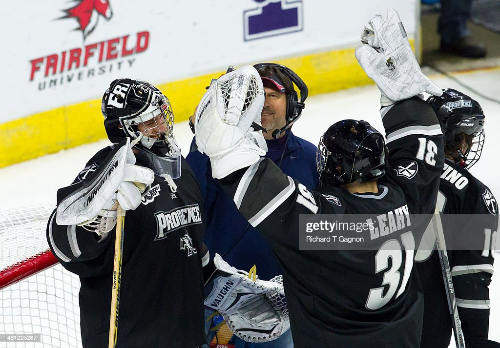 Jon Gillies #32 and Nicholas Luise #31 both of the Providence College Friars celebrate a victory against the Quinnipiac University Bobcats during the NCAA Division I Men's Ice Hockey East Regional Championship Semifinal at Webster Bank Arena on March 28, 2014 in Bridgeport, Connecticut.