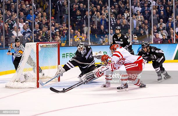 Jon Gillies of the Providence College Friars makes a stick save in the final minute of play against Cason Hohmann of the Boston University Terriers...