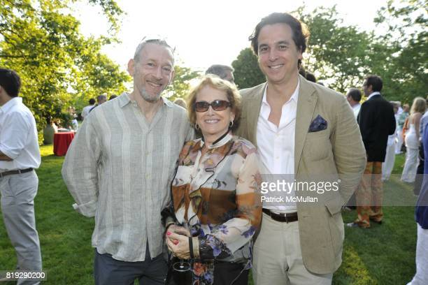 Jon Gilman Esther Newberg and Christopher Maya attend GODS LOVE WE DELIVERMid Summer Night Drinks Benefit at Home of Chad A Leat on June 19 2010 in...