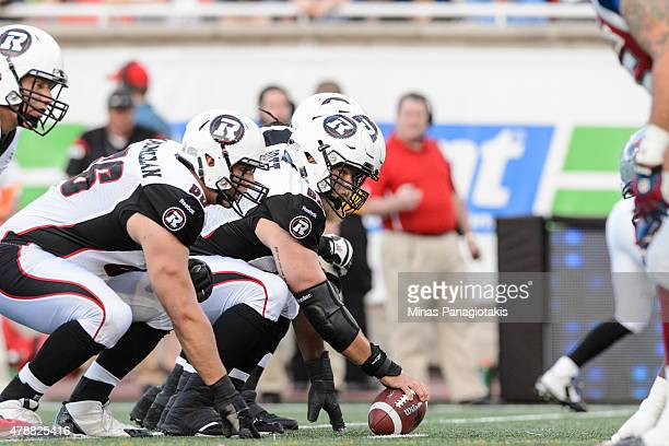 Jon Gott of the Ottawa Redblacks prepares to play the ball during the CFL game against the Montreal Alouettes at Percival Molson Stadium on June 25...
