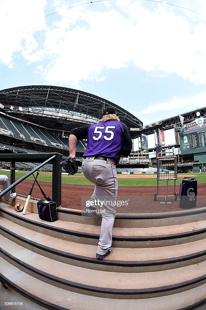 Jon Gray #55 of the Colorado Rockies runs up the dugout steps and heads to the bullpen prior to a game against the Arizona Diamondbacks at Chase Field on May 01, 2016 in Phoenix, Arizona.