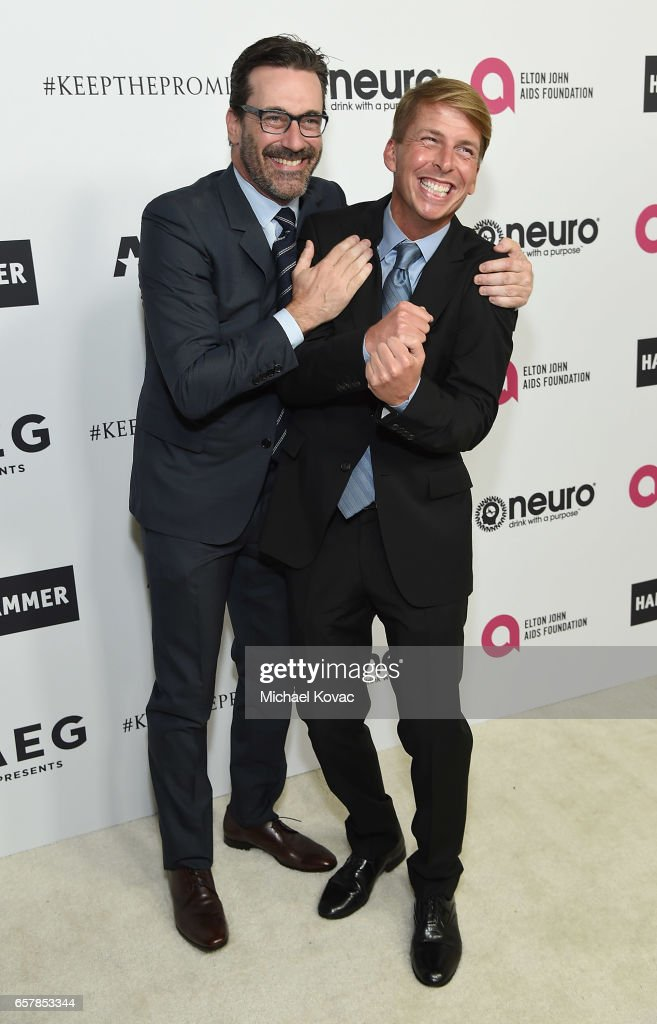 Jon Hamm (L) and Jack McBrayer celebrate Elton John's 70th Birthday and 50-Year Songwriting Partnership with Bernie Taupin benefiting the Elton John AIDS Foundation and the UCLA Hammer Museum at RED Studios Hollywood on March 25, 2017 in Los Angeles, California.