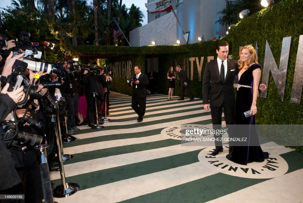 Jon Hamm (L) and Jennifer Westfeldt arrive at the Vanity Fair Oscar Party, for the 84th Annual Academy Awards, at the Sunset Tower on February 26, 2012 in West Hollywood, California. GONZALEZ