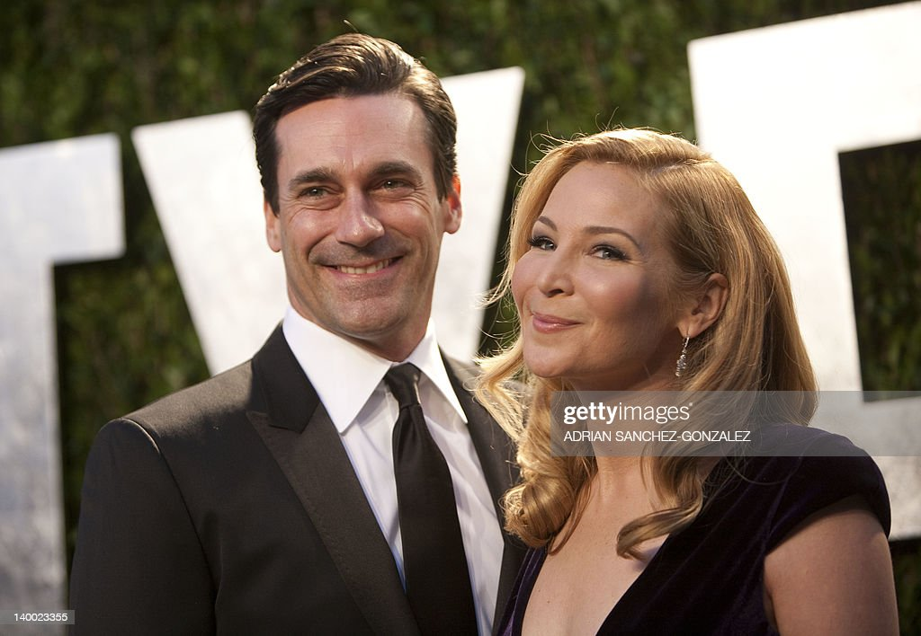 Jon Hamm (L) and Jennifer Westfeldt arrive at the Vanity Fair Oscar Party, for the 84th Annual Academy Awards, at the Sunset Tower on February 26, 2012 in West Hollywood, California.