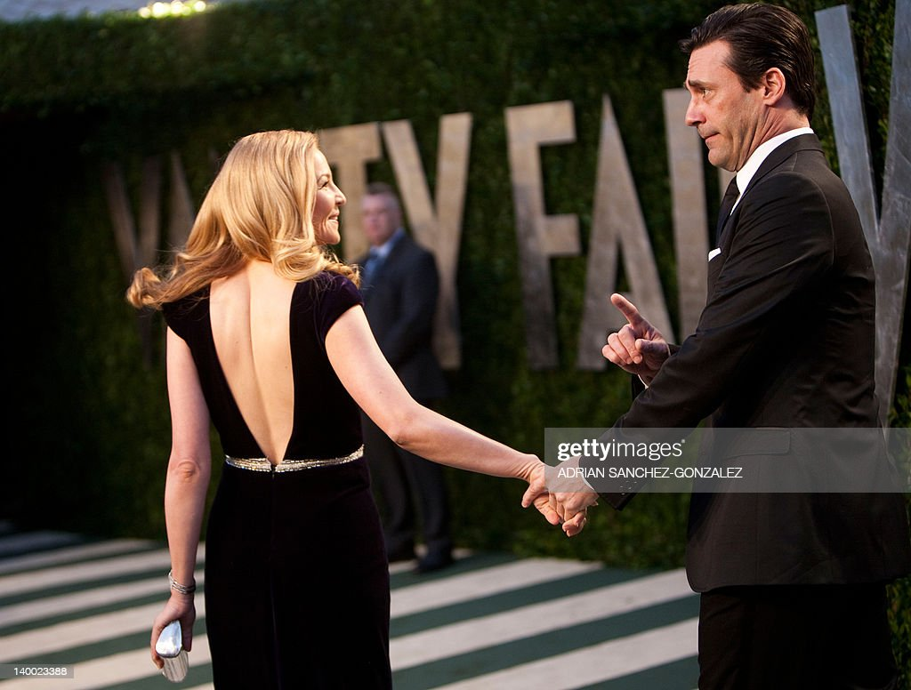 Jon Hamm (R) and Jennifer Westfeldt arrive at the Vanity Fair Oscar Party, for the 84th Annual Academy Awards, at the Sunset Tower on February 26, 2012 in West Hollywood, California.