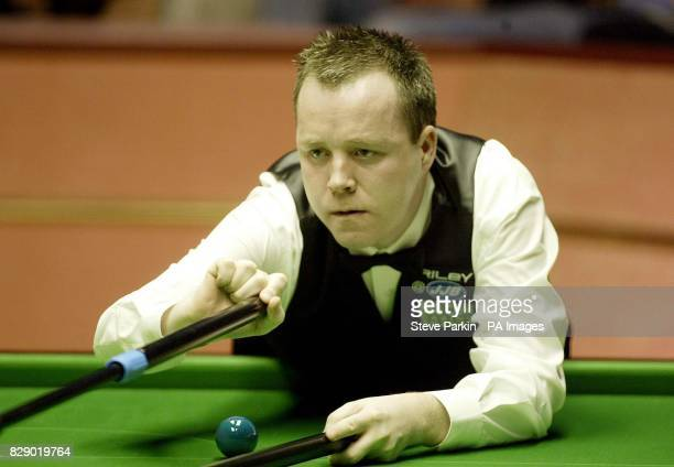 Jon Higgins in action in his match against Greame Dott at The 2004 Embassy World Snooker Championships at Sheffield