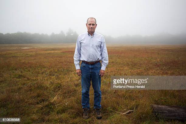 Jon Hill poses for a portrait in front of his family's blueberry field The property has been in their family for 80 years Hill has another job beside...