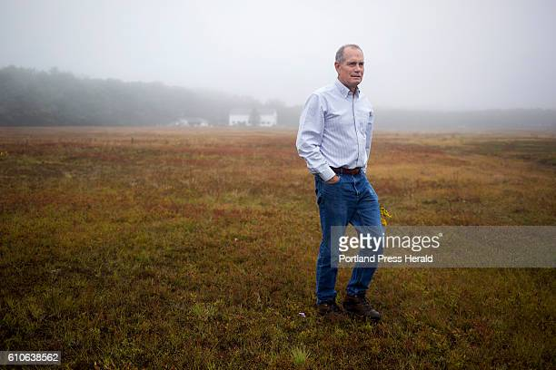Jon Hill walks through his family's blueberry field The property has been in their family for 80 years Hill has another job beside blueberries he...